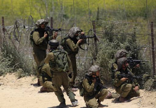 Israel army shoots at Hezbollah fighters on Golan borders