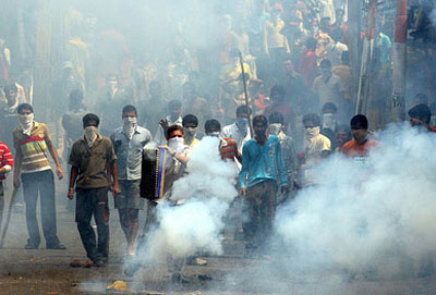 Protesters attack police as two Indian states fight over territory