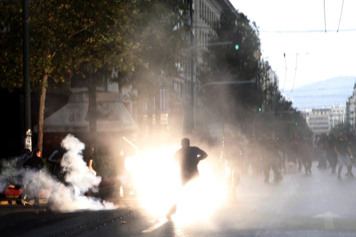 Greek police, protesters clash during rally to mark rapper killing