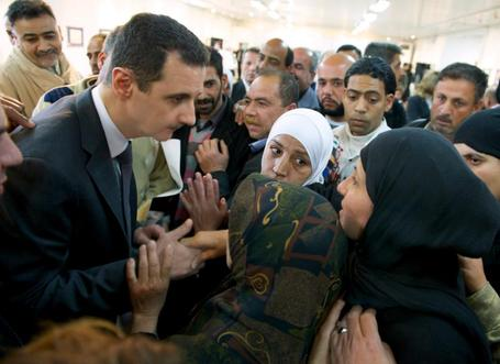 Assad visits displaced Syrians outside Damascus