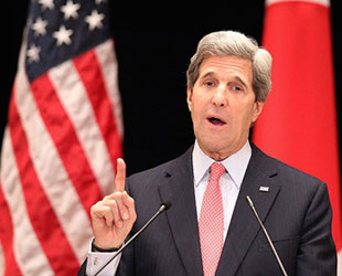 Palestinian protesters greet Kerry's visit