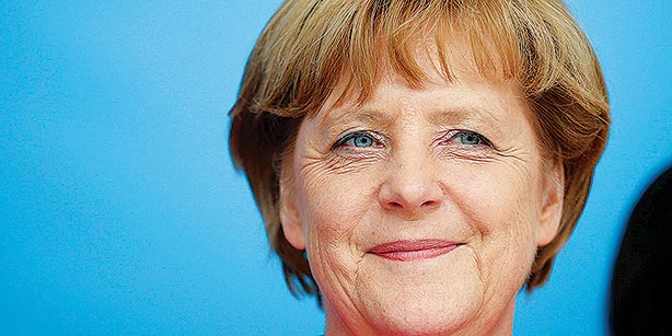 Merkel ready to cede on minimum wage to secure coalition