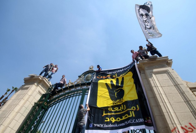 Student flashes 'Rabaa' sign at govt minister
