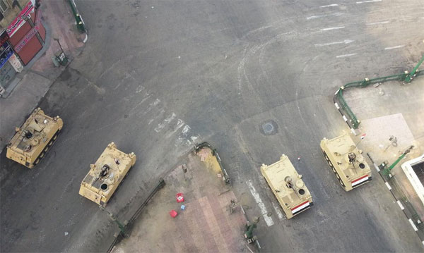 Egypt closes main squares before Rabia protests