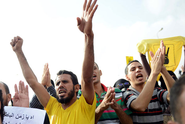 Egypt anti-coup bloc to call for 'revolution' on referendum day