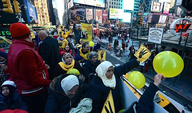 Egyptians protest coup on open buses in NYC