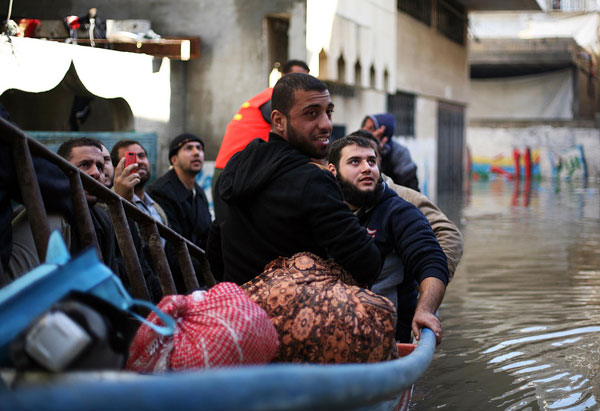 Gaza family shelters in taxicab from Storm Alexa