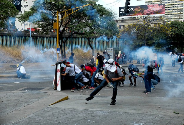 Venezuela frees most students detained in camp raids