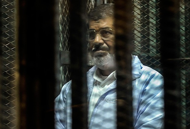 Egypt charges Morsi with passing state secrets