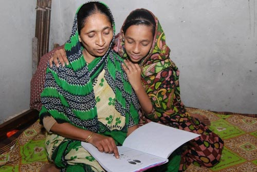 Children in Bangladesh teaching mothers how to read