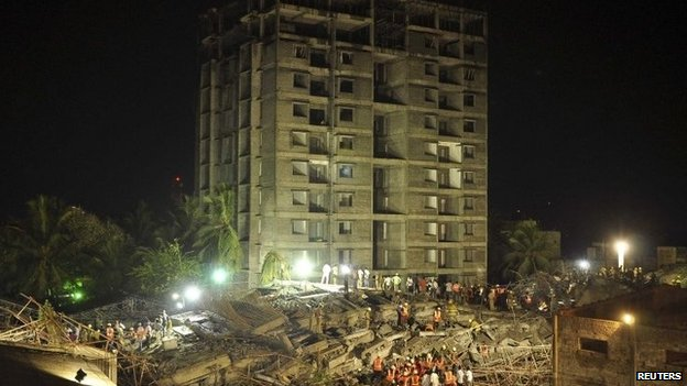 Building collapses kill 10 in India, trap over 100