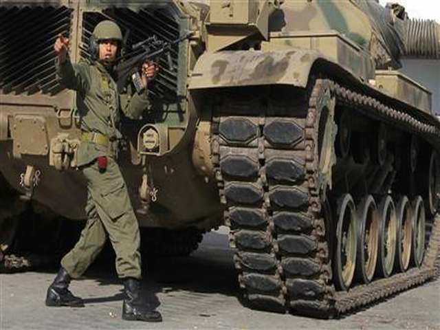 At least 14 Tunisian troops killed in mountain attack