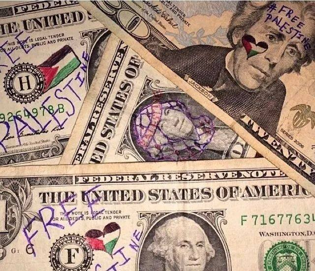 Freedom activists mark banknotes for Palestine