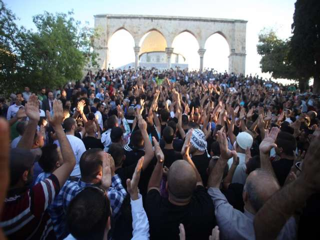 Palestinians march in East Jerusalem in Gaza solidarity