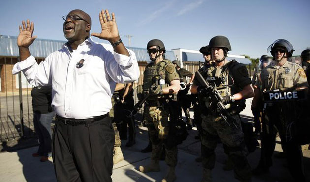 U.S. views on Missouri shooting vary starkly by race as tension continues