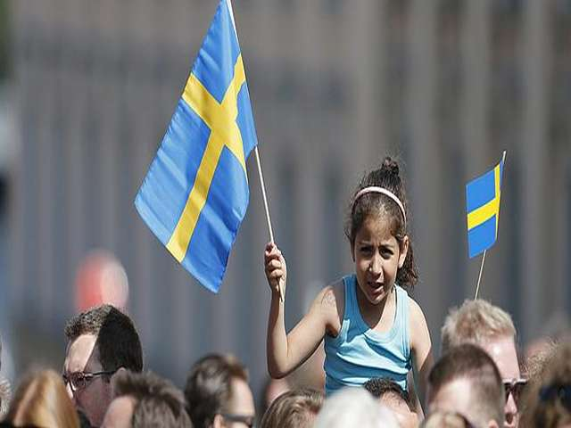 Swedish party urges tougher migrant policy to counter far-right