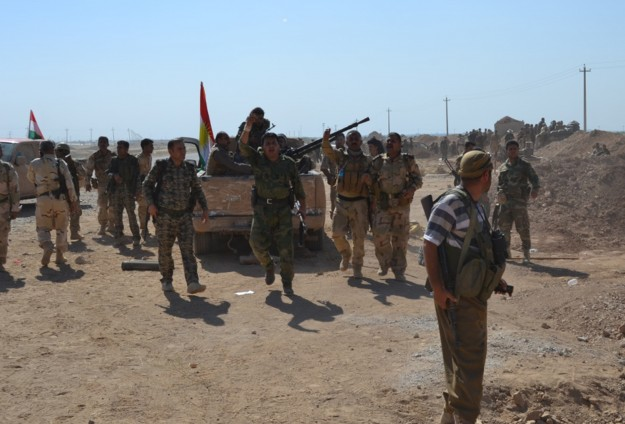 ISIS under pressure as Kurds take Syrian town