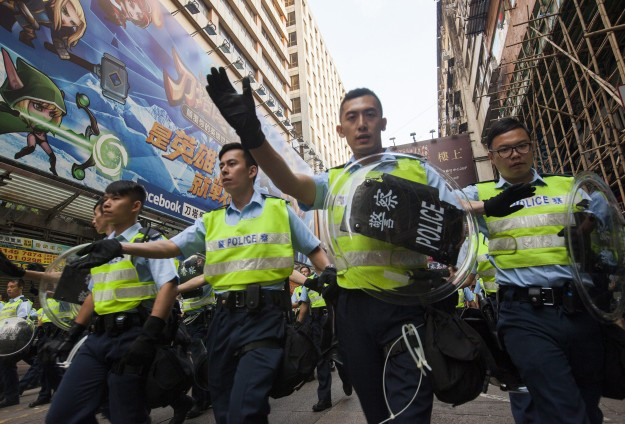 Thousands march to protest bid in Hong Kong