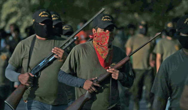 Mexico vigilante founder, 26 others arrested for murder