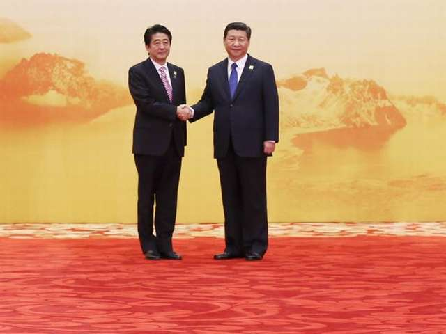China hopes Japan stays on 'path of peace' with new minister