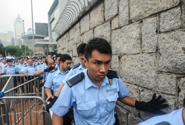 Hong Kong protester starts jail term for police assault