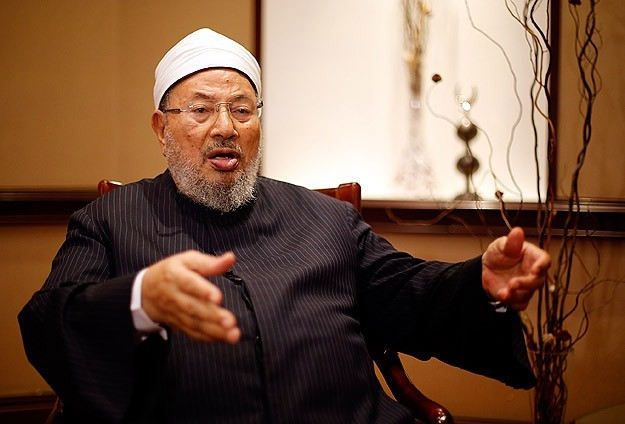 Al-Qaradawi urges protests in Egypt on uprising's anniversary