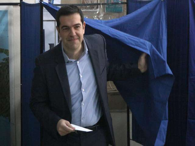 Spanish leftists' fate tied to Greece's Syriza: analysts