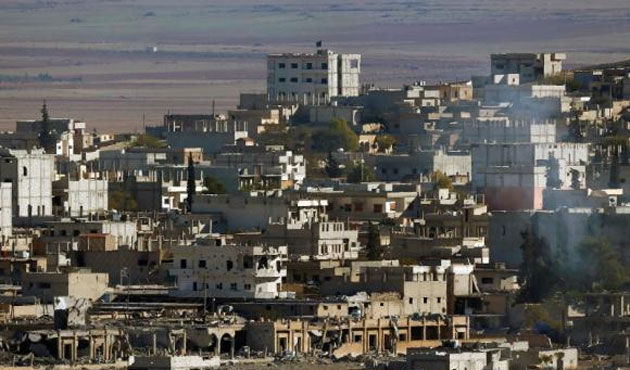 ISIL in Syria withdrawing from Kobani outskirts