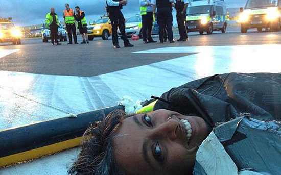 Climate change activists block Heathrow runway