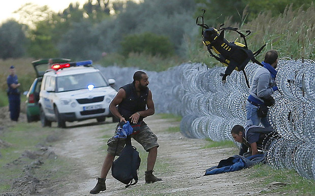 Hungary migrant crisis escalates as police fire teargas