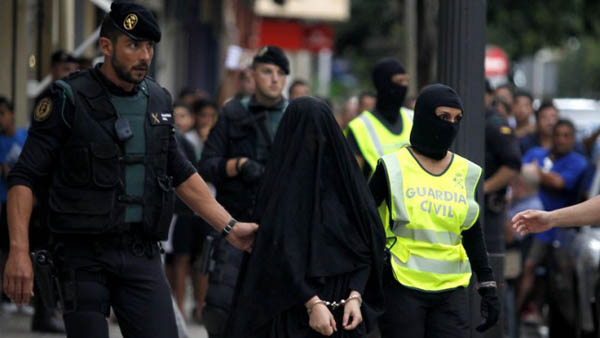 Woman in niqab paraded in Spanish style inquisition