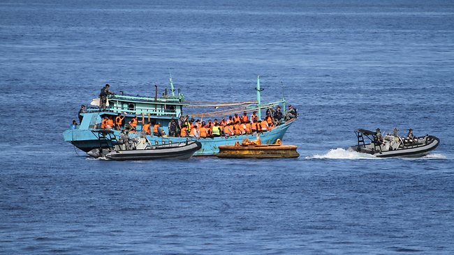 EU backs military action against people smugglers