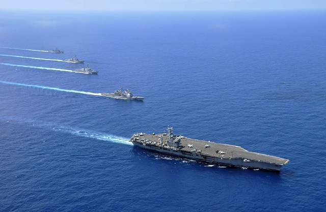 China, US stress consensus, restraint in disputed sea