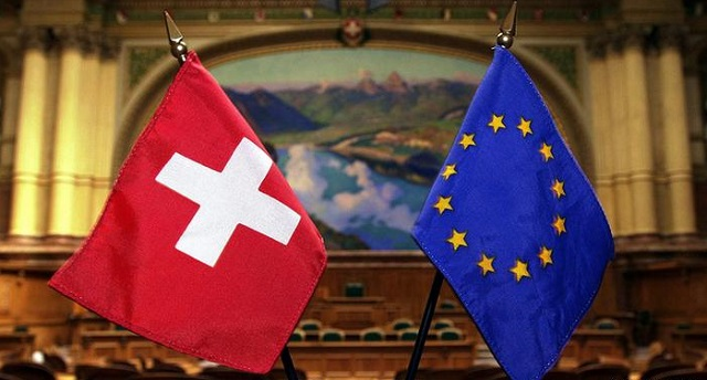 EU warns Switzerland after region's vote on migrant curbs