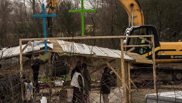 French demolish mosque, church at refugee camp