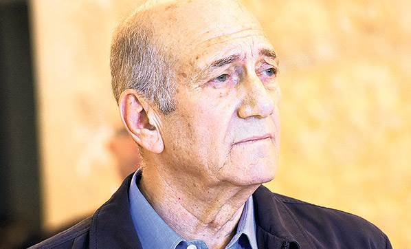 Israeli ex-PM Olmert freed from prison after parole in graft case