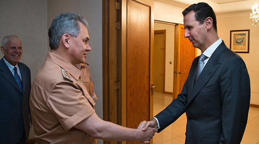 Russian defense minister meets Assad in Syria