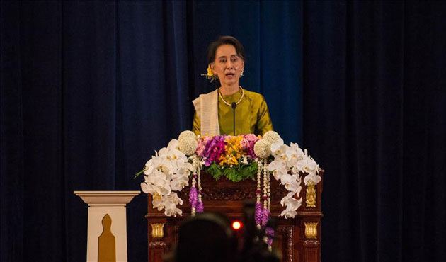 Suu Kyi tells Myanmar refugee in Thailand to come home