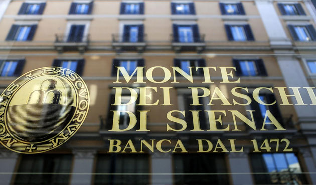Italian bank slumps on bad loan warning