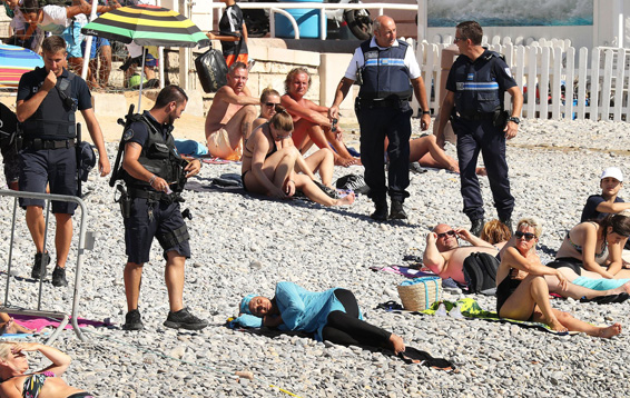 Armed French policemen force woman to strip