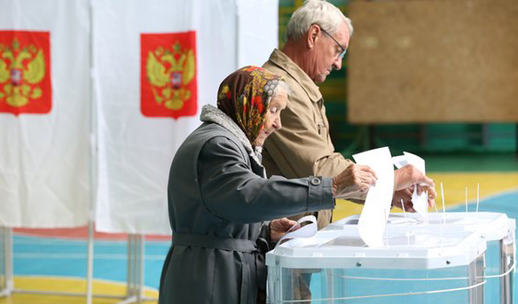 Russia votes in parliamentary polls with Putin secure