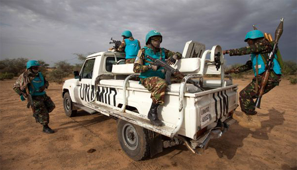 Peacekeepers leaving Sudan's Darfur found with arms