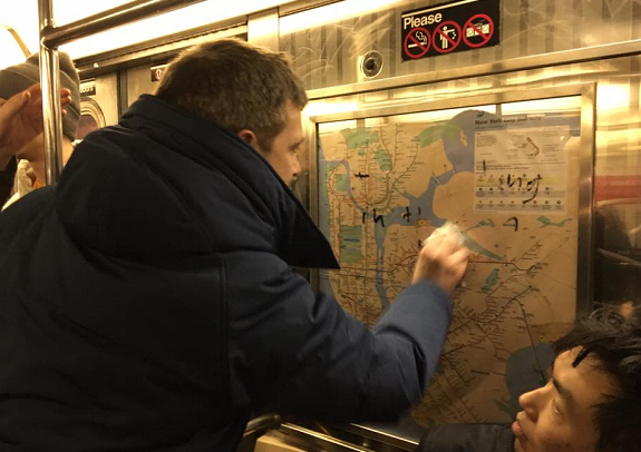New York subway riders tackle hate, remove swastikas