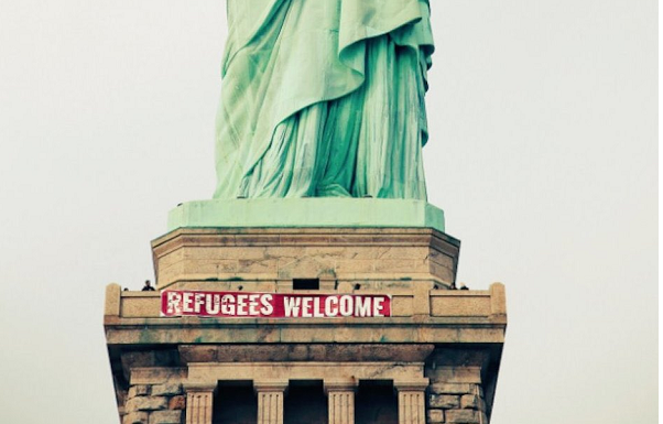 Activists hang 'Refugees Welcome' sign on Lady Liberty