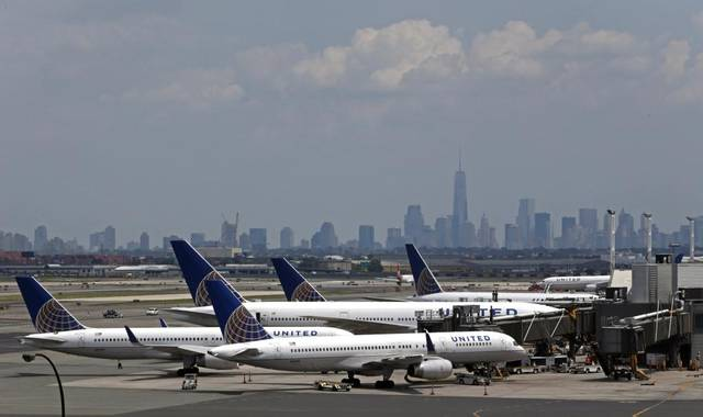 United, passenger dragged from plane reach settlement