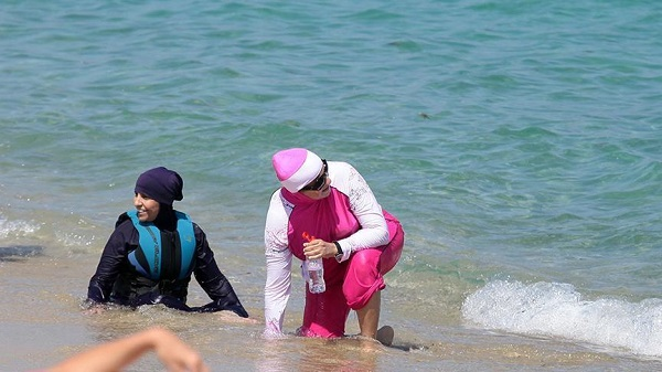 Women in burkinis stopped from swimming in Cannes