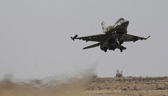 Israel warns over Iran's presence in Syria after air strikes
