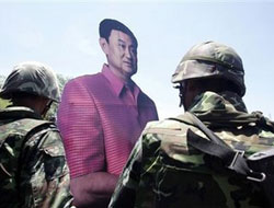 Thaksin tells followers not to mess with Thai junta