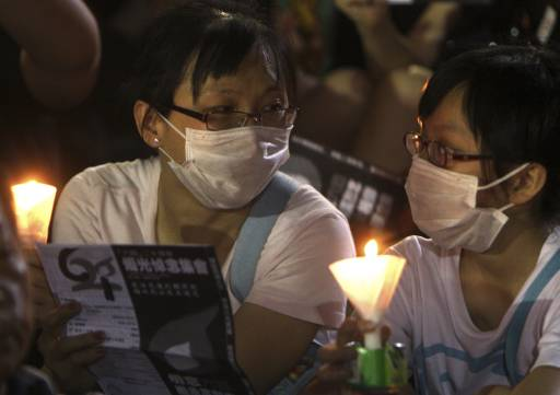 China frees three activists after Tiananmen anniversary