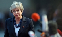 Britain's May clashes with Blair over Brexit